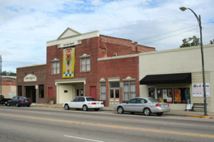 A street with cars parked in front of a theater in St George, South Carolina